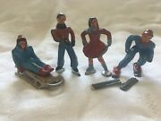 Lot Of Four Vintage Lead Figurines Ice Scaters/skier/sled Rider