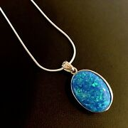 1 Large Oval Blue Pinfire Opal Oval Trellis Openwork Pendant And Chain Necklace