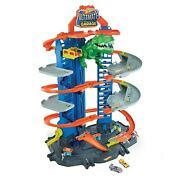 Hot Wheels City Ultimate Garage Playset With 2 Toy Cars And Robo-dinosaur
