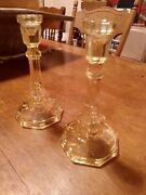 Two Vintage Yellow Glass Candlesticks