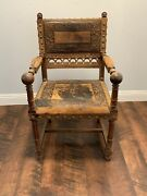 Antique Hand Carved Oak And Leather Chair With Straw Stuffing