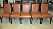 Sleek Dark Wood Dining Chairs With Orange/tan Upholstered Seat And Back