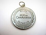 Vintage Collectible Medal 65 Plus Careamerica Sales Olympics Silver Tone