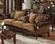 Delphina Traditional Brown Faux Leather And Chenille Sofa W/ Carved Details