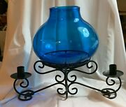 Black Scrolled Iron Centerpiece 2 Candlestick Holders And Large Blue Glass Vase