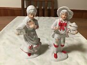 Porcelain Man Andwoman White Trimmed In Red Colonial Bearing Gifts.7 +andrdquo Tall