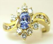 Ladies 18k Yellow Gold Oval Tanzanite And Diamond Prongs And Channel Set Ring