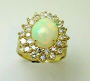 Ladies 14k Yellow Gold Oval Ethiopian Opal And Diamond Ring