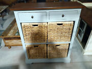 Blue Cabinet With Wicker Baskets