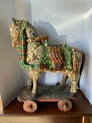 20th C. Multi-colored Distressed Look Carved Wooden Decorative Horse On Wheels