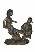 A Boy And A Girl Playing Seesaw Bronze Statue - Size 17l X 33w X 36h.