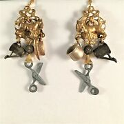 Whimsical Earrings Of Vintage Metal Cracker Jack Charms Prizes Home And Hearth