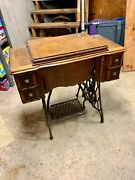 Antique Singer Manufacturing Co. Sewing Cabinet And Iron Treadle Base 1900's