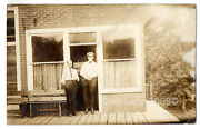 C.1913 Antique Rppc Real Photo Postcard Two Men In Front Of Store Front Station