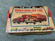12 Assorted World Wide Van Line Series Vintage Toy Moving Trucks - Boxed