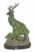 Two Deers Bronze Statue With A Green Patina Finish - Size 15l X 22w X 32h.
