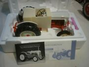 A Franklin Mint 1953 Ford Jubilee Farm Tractor. Boxed