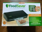 Foodsaver Fm2100 Vacuum Sealing System-new Sealed W/ Bags Roll Storage And Cutter