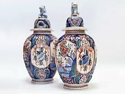 19 C Pair Of Large Delftware Vases And Covers