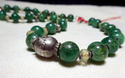 A Necklace With Ancient Green Gemstone Rock Crystal Glass And Antique Silver Beads