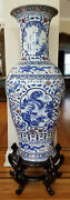 Large Chinese Porcelain Blue And White Vase With Hand Painted Design And Stand.