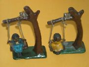 Vintage 1905 Cast Iron Boy And Girl Figurines In Swing 4 1/2 X 2 1/2 Inches