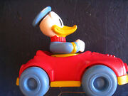 Vintage Disney Productions Donald Duck Red Car Pull Toy Blue Tires Still Works