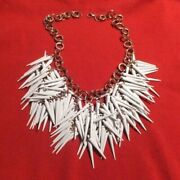 Clustered Tusk-like Ivory Tone Spiked Necklace Scattered Across A Rose Gold Chai