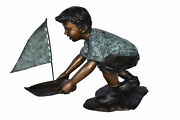 Boy Sends His Toy Boat On The Water Bronze Statue - Size 16l X 33w X 24h.