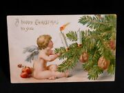 Tiny Angle Blowing Out Candles-apples And Nuts For Treats On Xmas Tree-by Tuck
