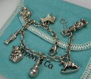 And Co Vintage Sterling Silver Dog Cat Teddy Clown Horse 7 Charm Bracelet