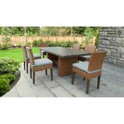 Laguna Rectangular Outdoor Patio Dining Table With 6 Armless Chairs In Spa