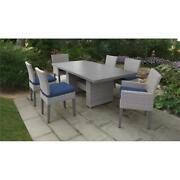Florence Rectangular Patio Dining Table 4 Armless Chairs 2 Arm Chairs In Navy