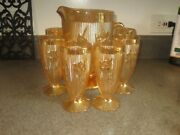 Jeannette Amber Carnival Glass Pitcher And Six Glasses - Iris And Herringbone