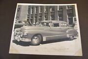 Vintage Black And White Photo Of Classic Sedan At Bostitch Company