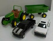 John Deere Toy Tractor With A Trailer And Two Pickup Trucks