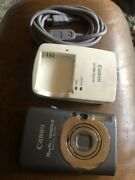 Pre Owned Canon Powershot Sd1200 Is Digital Camera Grey W/ Charger And Cords