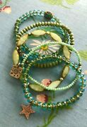 Turquoise Bracelets With Sterling Silver Charms And Tibetan Inlaid Bead