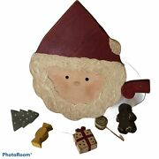 Primitive Wooden Santa With Wooden Toys On A Wire Around Him