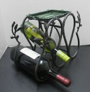 5 Bottle Wine Rack Or Flower Stand Black Wrought Iron With Decorative Leaf Motif