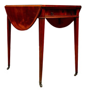Flame Mahogany Oval Pembroke Table With Banded Inlay On Casters
