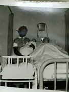 African American Nurse Holding White Doll With Male Mannequin In Bed Crewe Va