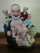 Antique Chinese Porcelain Laughing Buddha Statue.