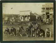 Photograph Of The Town Of Tuolumne, California With Football Team On Main Street