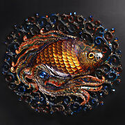 Manual Work Of Authorship The Fish Is Gold With A Blue Stone.