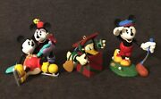 A Trio Of Hallmark Keepsake Christmas Ornaments With Disney Characters Featured.