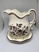 Creamer W/ Attached Saucer. Cream Colored With Brown Trim And Flowers. Japan