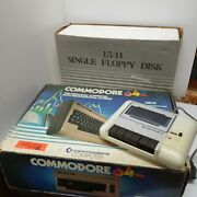 Commodore 64 With Cassette And 1541 Floppy Disk Drive And Boxes