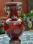 19th Century Sang De Boeuf Baluster Vase With Elephant Mask And Loop Handles.