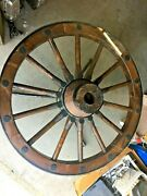 Antique 38.5andrdquo Wagon Wheel Coffee Table With Clear Glass And 3 Leg Iron Base